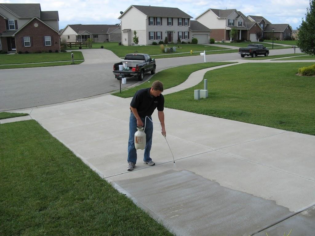 Man sealing concrete