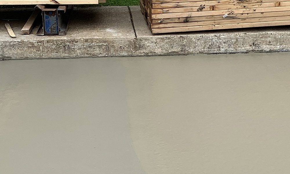 Impede IntraSeal new concrete parking lot